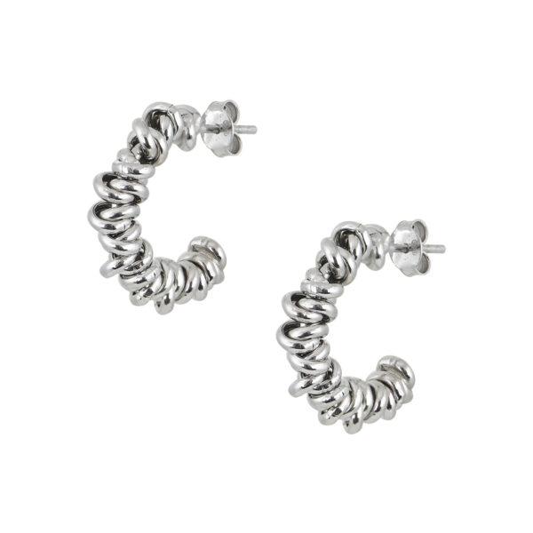 Ασημένια σκουλαρίκια κρίκοι που αποτελούνται από μικρές ροδέλες με μικρή κίνηση. Στέκεται στον λοβό του αυτιού με βελόνα κι έχει πεταλούδα για κούμπωμα